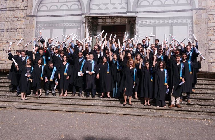 Students collect their doctorates at the European University Institute